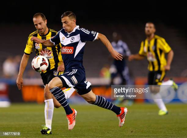 James Troisi of the Victory scores past Andrew Durante of the Phoenix during the round four ALeague match between Melbourne Victory and Wellington...