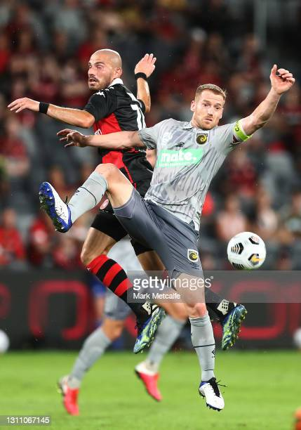 James Troisi of the Wanderers and Oliver Bozanic of the Mariners compete for a header during the A-League match between Western Sydney Wanderers FC...
