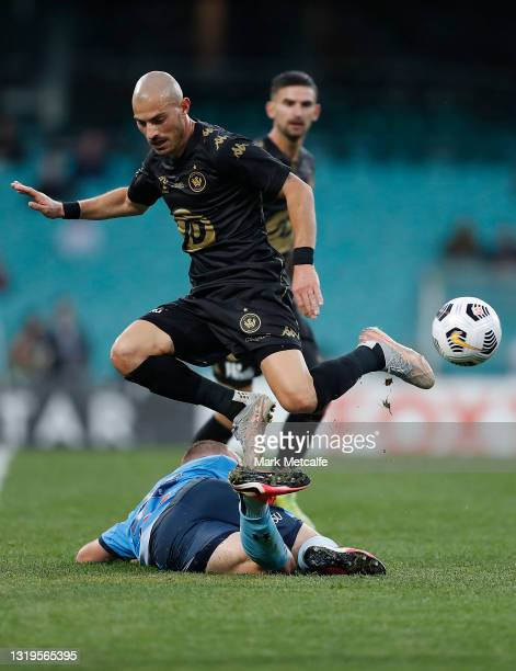 James Troisi of the Wanderers and Rhyan Grant of Sydney FC compete for the ball during the A-League match between Sydney FC and Western Sydney...