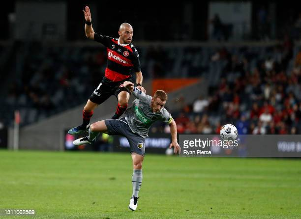 James Troisi of the Wanderers competes for the ball against Oliver Bozanic of the Mariners during the A-League match between Western Sydney Wanderers...