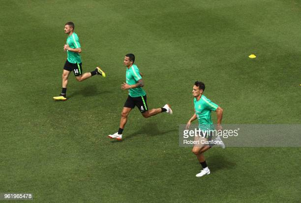 James Troisi Tim Cahill and Trent Sainsbury of Australia run during the Australian Socceroos Training Session at the Gloria Football Club on May 24...