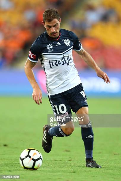 James Troisiof the Victory controls the ball during the round 11 ALeague match between the Brisbane Roar and the Melbourne Victory at Suncorp Stadium...