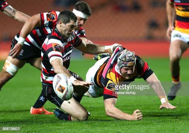 James Tucker of Waikato loses the ball in a tackle by Stephen Donald during the round two Mitre 10 Cup match between Waikato and Counties Manuka at...