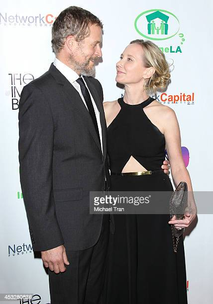 James Tupper and Anne Heche arrive at The Imagine Ball held at House of Blues Sunset Strip on August 6 2014 in West Hollywood California