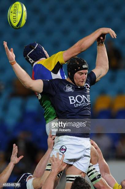 James Turner of Queensland Country competes the ball with Michael Wells of the Rays during the round four National Rugby Championship match between...