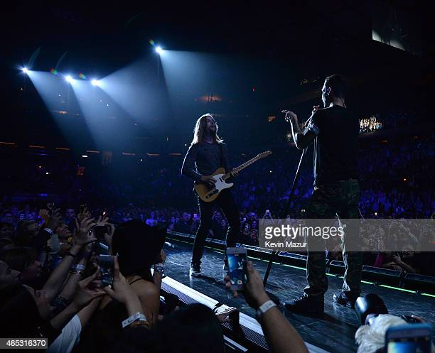 James Valentine and Adam Levine of Maroon 5 perform onstage during the 'V' tour at Madison Square Garden on March 5 2015 in New York City