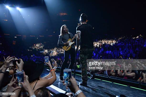 James Valentine and Adam Levine of Maroon 5 perform onstage during the V tour at Madison Square Garden on March 5 2015 in New York City