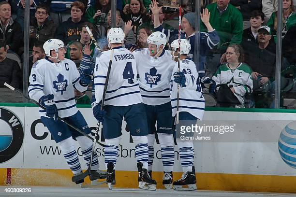 James van Riemsdyk Cody Franson Dion Phaneuf and Nazem Kadri of the Toronto Maple Leafs celebrate a goal against the Dallas Stars at the American...
