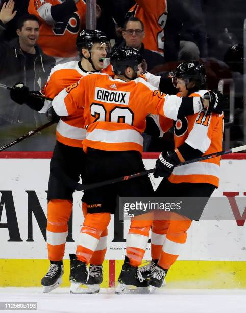 James van Riemsdyk of the Philadelphia Flyers celebrates his goal in the third period with teammates Claude Giroux and Travis Konecny at Wells Fargo...