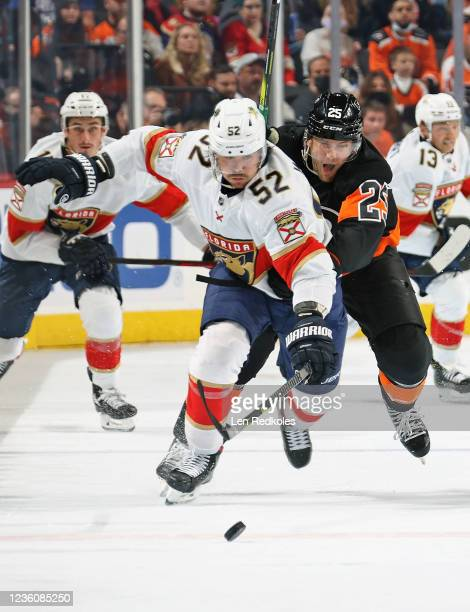 James van Riemsdyk of the Philadelphia Flyers chases down MacKenzie Weegar of the Florida Panthers as they pursue the loose puck at the Wells Fargo...