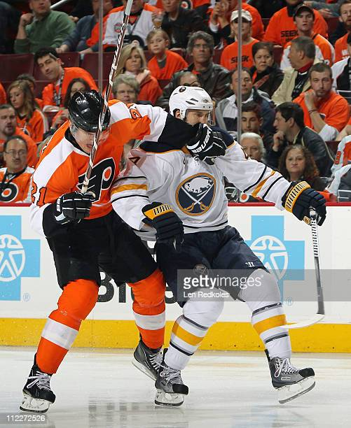 James van Riemsdyk of the Philadelphia Flyers tangles up with Steve Montador of the Buffalo Sabres in Game Two of the Eastern Conference...