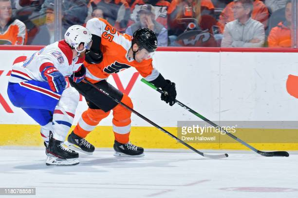 James van Riemsdyk of the Philadelphia Flyers tries to fight his way past Jeff Petry of the Montreal Canadiens during the third period at Wells Fargo...