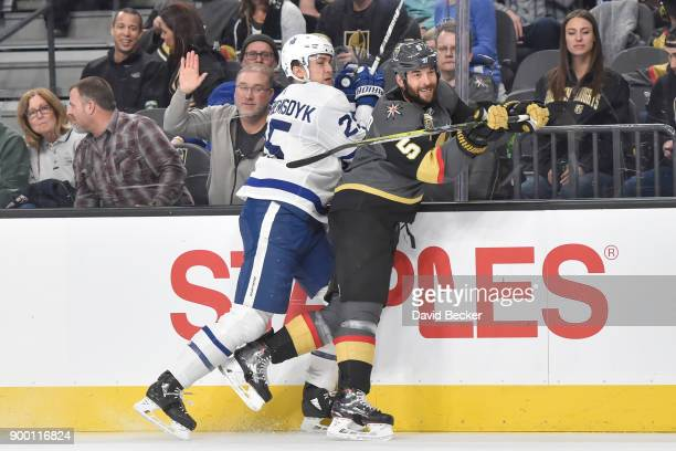 James van Riemsdyk of the Toronto Maple Leafs and Deryk Engelland of the Vegas Golden Knights collide during the game at TMobile Arena on December 31...
