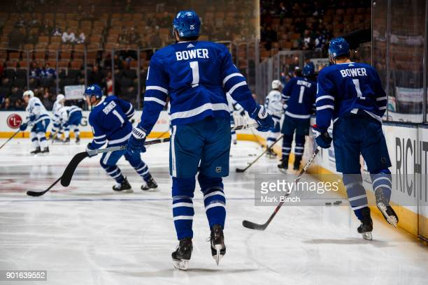James van Riemsdyk of the Toronto Maple Leafs and teammates wear jersey's honouring Leafs legend Johnny Bower during warmup before facing the Tampa...