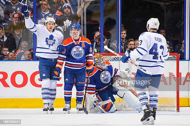 James van Riemsdyk of the Toronto Maple Leafs celebrates the goal of his teammate Phil Kessel against Richard Bachman of the Edmonton Oilers during...
