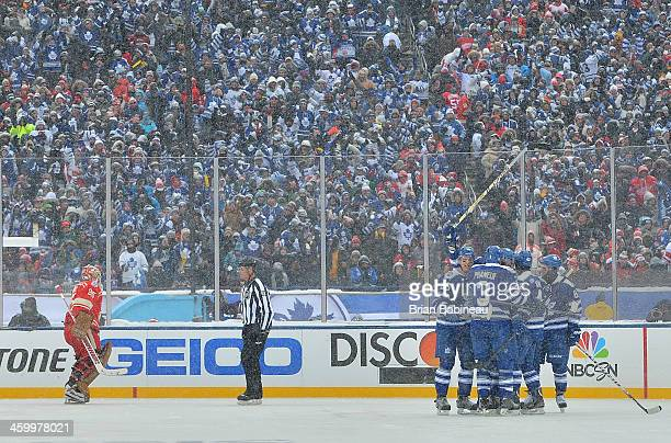 James van Riemsdyk of the Toronto Maple Leafs celebrates with teammates Carl Gunnarsson, Dion Phaneuf, Tyler Bozak and Phil Kessel after scoring in...