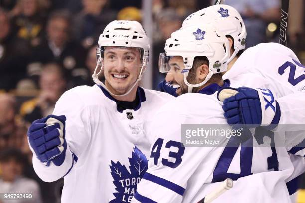 James van Riemsdyk of the Toronto Maple Leafs celebrates with Nazem Kadri and Tyler Bozak after scoring a goal against the Boston Bruins during the...