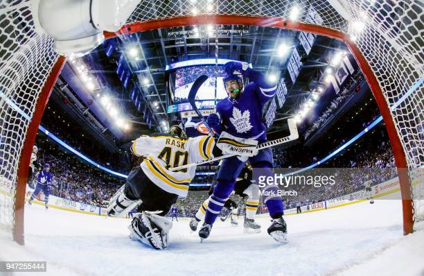 James van Riemsdyk of the Toronto Maple Leafs collides with Tuukka Rask of the Boston Bruins in Game Three of the Eastern Conference First Round...