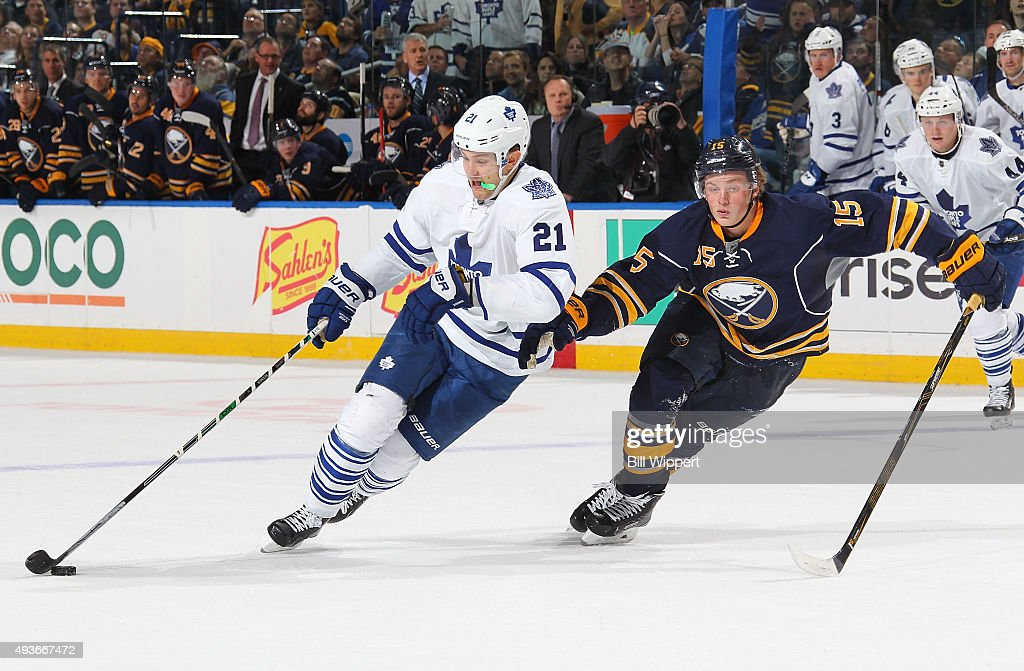 James van Riemsdyk #21 of the Toronto Maple Leafs controls the puck against Jack Eichel #15 of the Buffalo Sabres during an NHL game on October 21, 2015 at the First Niagara Center in Buffalo, New York. Buffalo won, 2-1.