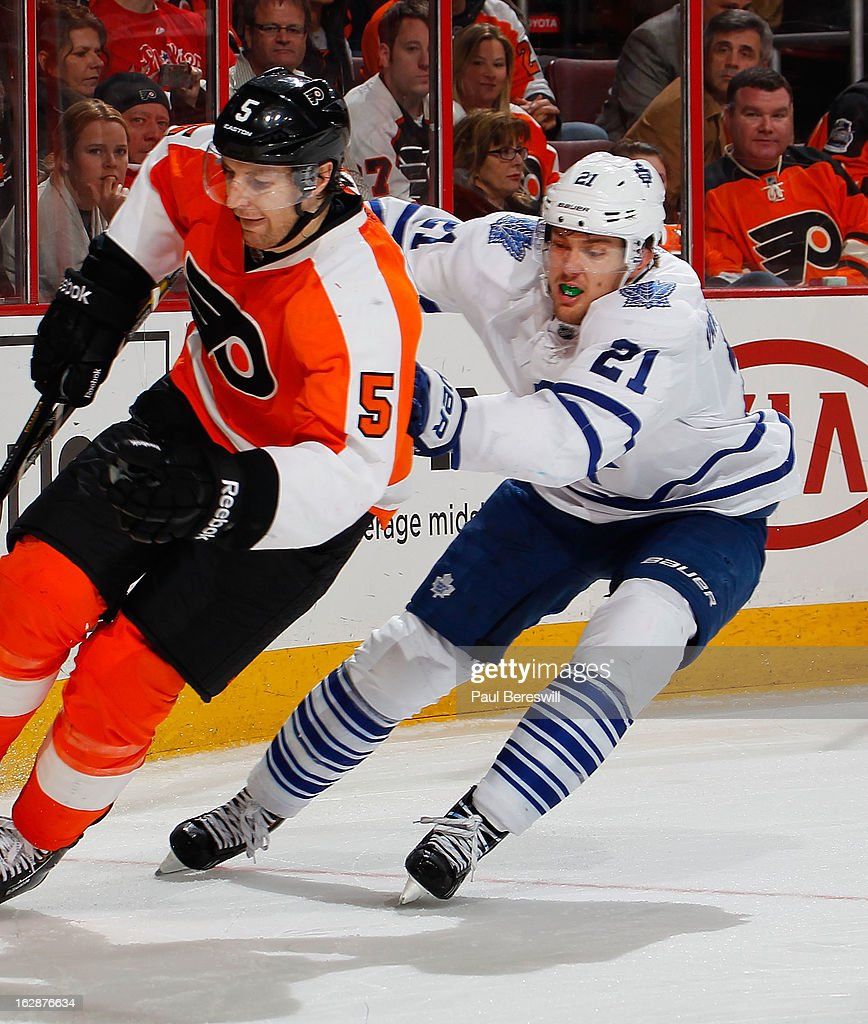 James van Riemsdyk #21 of the Toronto Maple Leafs covers Braydon Coburn #5 of the Philadelphia Flyers in an NHL Hockey game at Wells Fargo Center on February 25, 2013 in Philadelphia, Pennsylvania.
