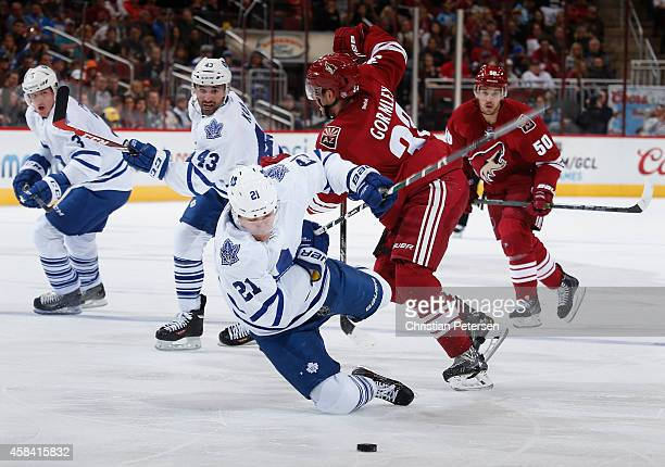 James van Riemsdyk of the Toronto Maple Leafs is tripped up by Brandon Gormley of the Arizona Coyotes for a penalty during the second period of the...