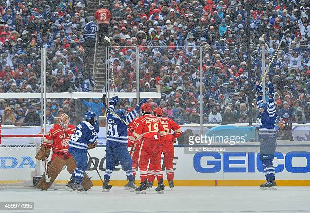 James van Riemsdyk of the Toronto Maple Leafs reacts after scoring in the second period against goaltender Jimmy Howard of the Detroit Red Wings...