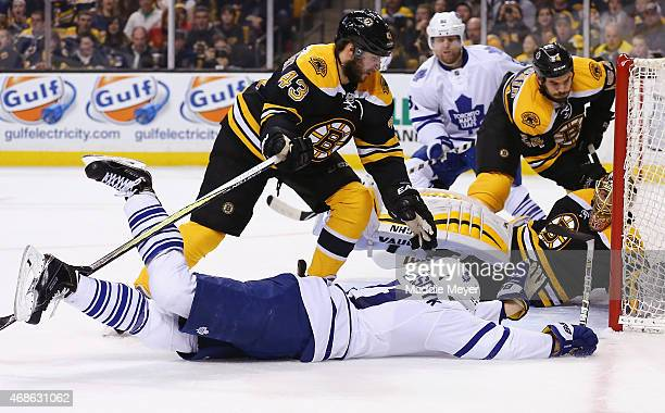 James van Riemsdyk of the Toronto Maple Leafs scoes against Tuukka Rask of the Boston Bruins during the second period at TD Garden on April 4 2015 in...