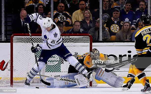 James van Riemsdyk of the Toronto Maple Leafs scores as a Tuukka Rask of the Boston Bruins takes a stick to the face in the third period during Game...