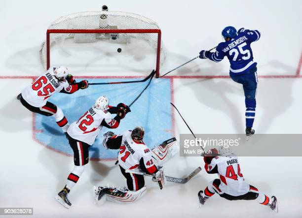 James van Riemsdyk of the Toronto Maple Leafs scores on Craig Anderson of the Ottawa Senators during the third period at the Air Canada Centre on...