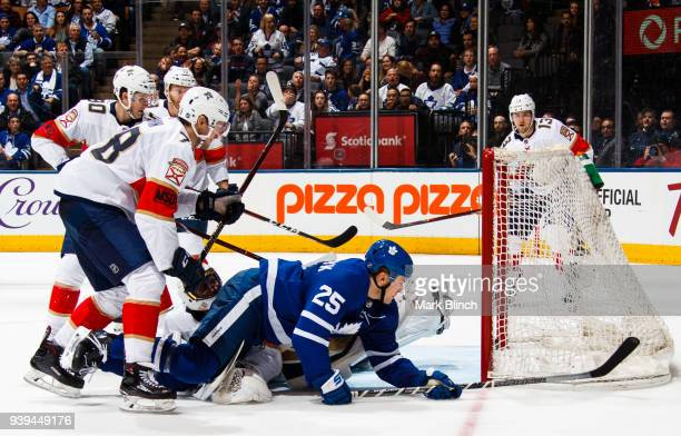 James van Riemsdyk of the Toronto Maple Leafs scores on Roberto Luongo of the Florida Panthers as Maxim Mamin Jared McCann and Michael Matheson watch...