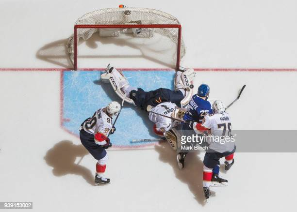 James van Riemsdyk of the Toronto Maple Leafs scores on Roberto Luongo of the Florida Panthers and teammates Maxim Mamin and Jared McCann during the...