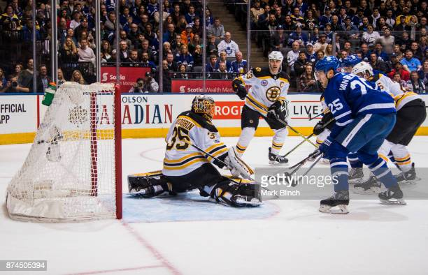 James van Riemsdyk of the Toronto Maple Leafs scores the game tying goal against Anton Khudobin and Zdeno Chara of the Boston Bruins during the third...