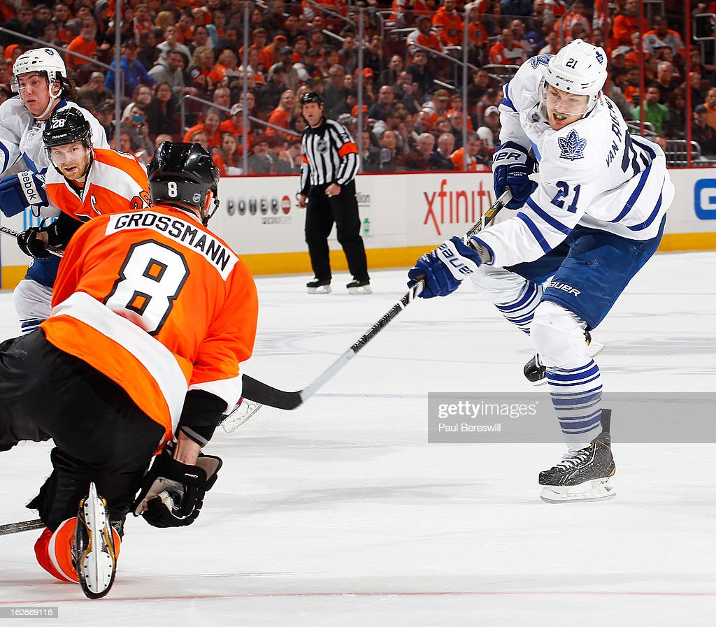 James van Riemsdyk #21 of the Toronto Maple Leafs shoots on goal as Nicklas Grossmann #8 of the Philadelphia Flyers drops to the ice to try to block it in the third period of an NHL Hockey game at Wells Fargo Center on February 25, 2013 in Philadelphia, Pennsylvania.