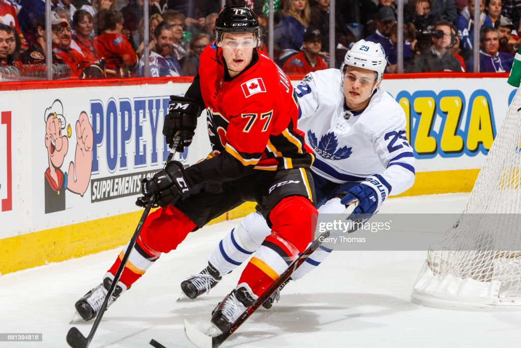 James van Riemsdyk #25 of the Toronto Maple Leafs tryes to steal the puck from Mark Jankowski #77 of the Calgary Flames in an NHL game against the Toronto Maple Leafs at the Scotiabank Saddledome on November 28, 2017 in Calgary, Alberta, Canada.