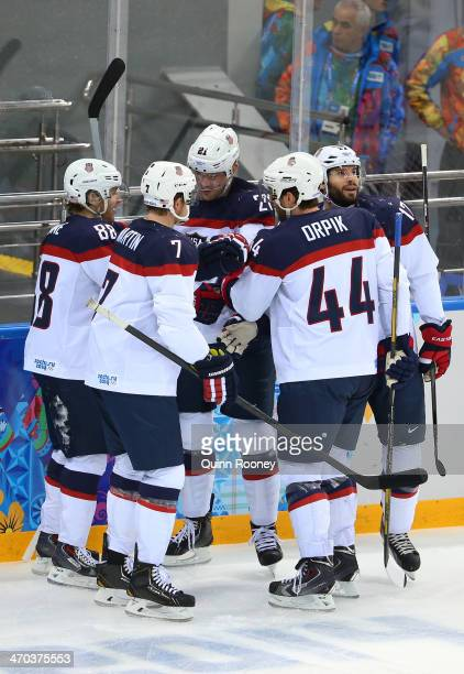 James van Riemsdyk of the United States celebrates with his teammates after scoring a goal in the first period against Ondrej Pavelec of the Czech...