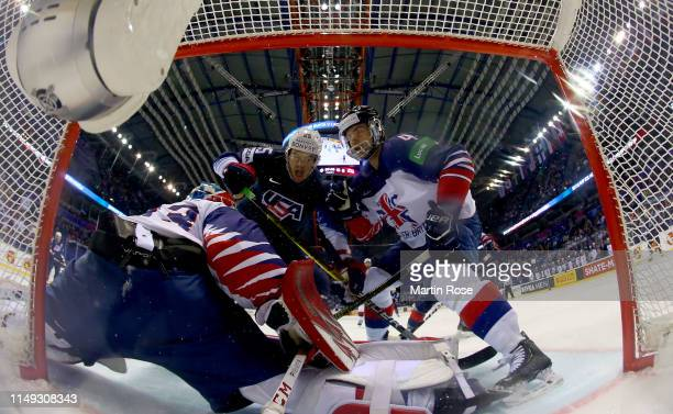 James van Riemsdyk of United States challenges Stephen Lee of Great Britain during the 2019 IIHF Ice Hockey World Championship Slovakia group A game...