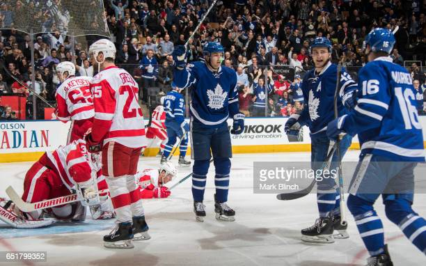 James van Riemsdyk Tyler Bozak Mitch Marner celebrate a goal by Alexey Marchenko of the Toronto Maple Leafs against the Detroit Red Wings during the...