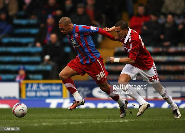 James Vaughan of Crystal Palace fends off Seb Hines during the npower Championship match between Crystal Palace and Norwich City at Selhurst Park on...