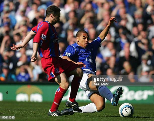 James Vaughan of Everton who made his debut as the youngest player in the history of the club tackles Michael Hughes of Crystal Palace during the...