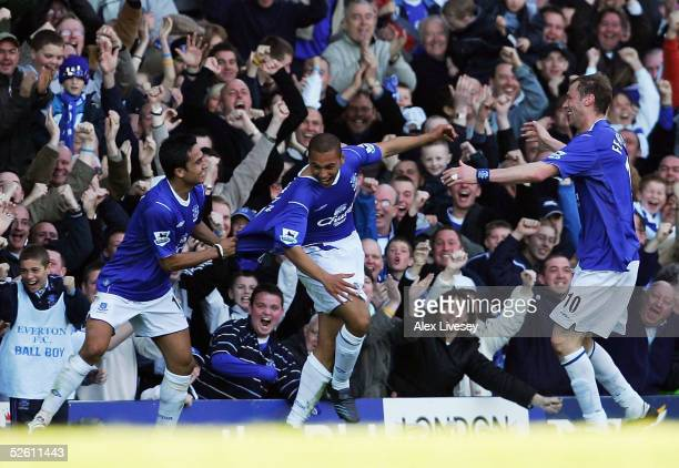 James Vaughan of Everton who made his debut as the youngest player in the history of the club celebrates his goal with Tim Cahill and Duncan Ferguson...