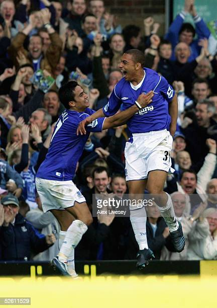 James Vaughan of Everton who made his debut as the youngest player in the history of the club celebrates his goal with Tim Cahill during the Barclays...
