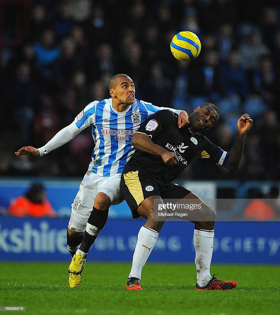 James Vaughan of Huddersfield battles Wes Morgan of Leicester during the FA Cup Fourth Round match between Huddersfield Town and Leicester City at the Galpharm Stadium on January 26, 2013 in Huddersfield, England.