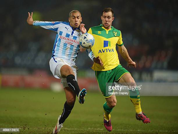 James Vaughan of Huddersfield Town and Steven Whittaker of Norwich City battle for the ball during the Sky Bet Championship match between...