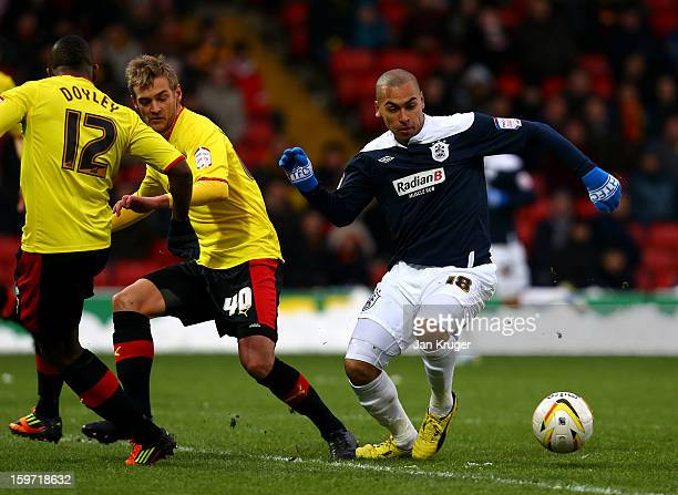 James Vaughan of Huddersfield Town basttles with Joel Ekstrand of Watford during the npower Championship match between Watford and Huddersfield Town...