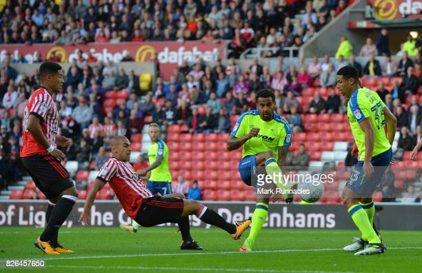 James Vaughan of Sunderland has his shot on goal blocked by Tom Huddlestone of Derby County during the Sky Bet Championship match between Sunderland...