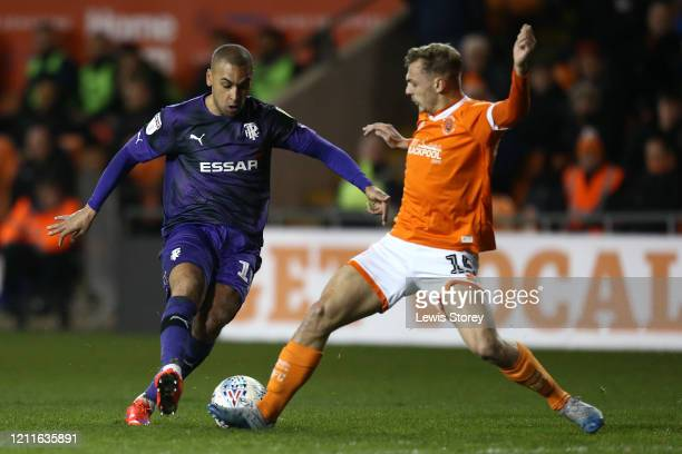 James Vaughan of Tranmere Rovers is tackled by Kiernan Dewsbury-Hall of Blackpool during the Sky Bet League One match between Blackpool and Tranmere...