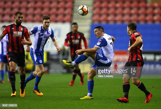 James Vaughan of Wigan Athletic under pressure from Ryan Fraser of AFC Bournemouth during The Emirates FA Cup Third Round Replay between Wigan and...