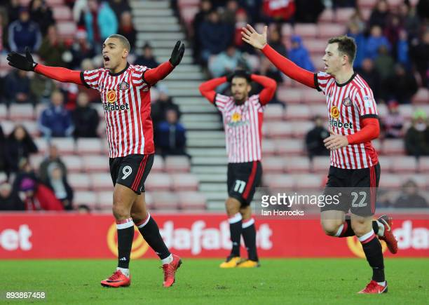 James Vaughn and Donald Love of Sunderland appeal for a free kick during the Sky Bet Championship match between Sunderland and Fulham at Stadium of...