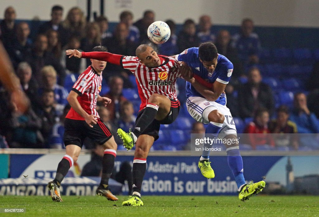James Vaughn of Sunderland (L) tangles with Jordan Spence of Ipswich during the Sky Bet Championship match between Ipswich Town and Sunderland at Portman Road on September 26, 2017 in Ipswich, England.