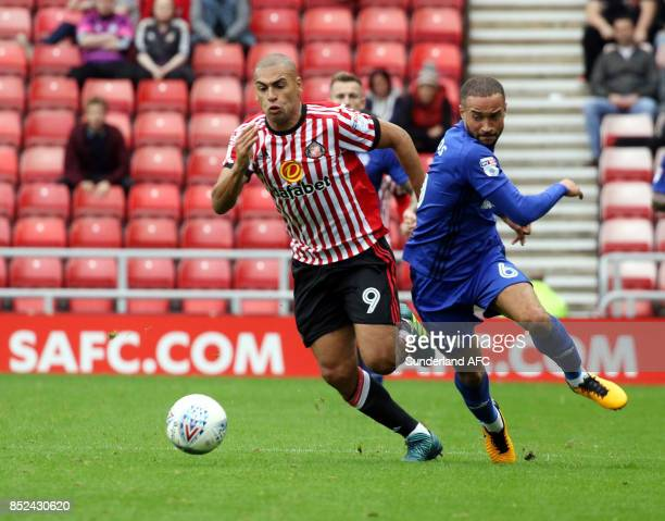 James Vaughn of Sunderland tries to takes on Jazz Richards of Cardiff during the Sky Bet Championship match between Sunderland and Cardiff City at...